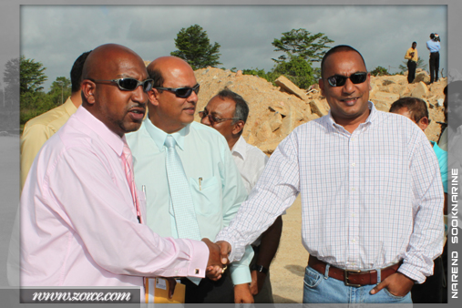 Minister of Sports, Anil Roberts, shakes hands with the Trinidad Rocket Sheldon Bissessar